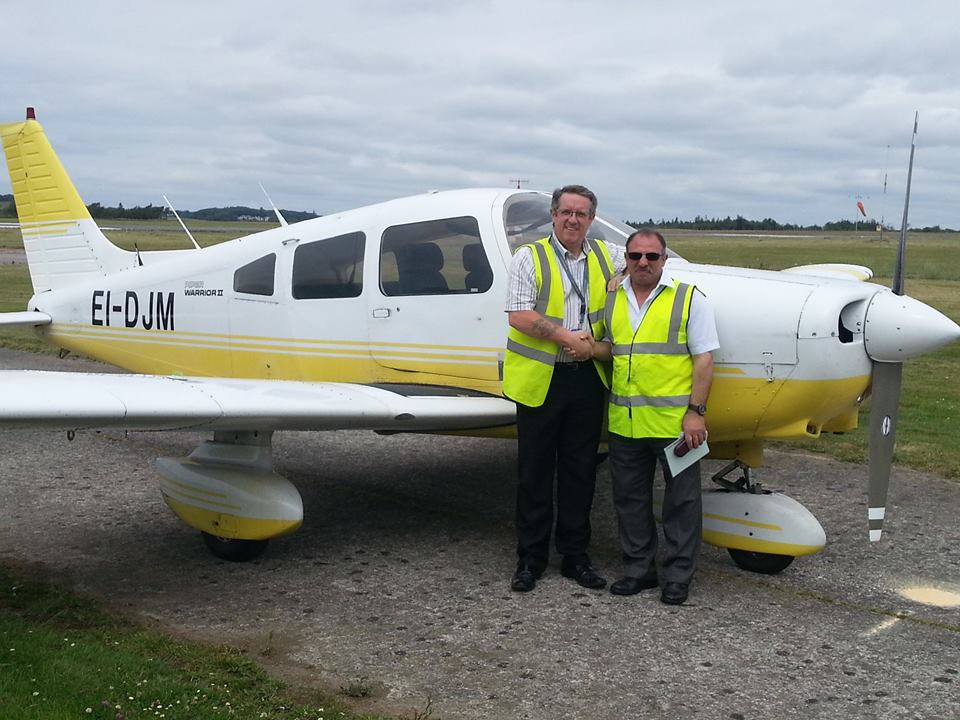 FI Brian Power congratulates John Saliba after his first solo in our Piper Warrior EI-DJM at Waterford Aero Club.