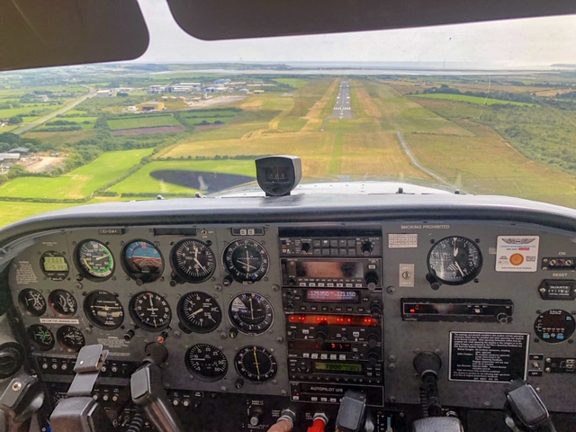 C172 EI-GWY on final approach to runway 21 at Waterford Airport