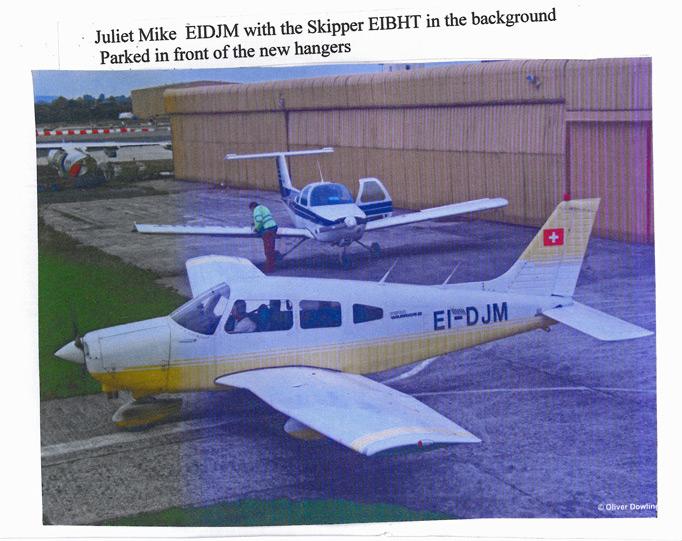 Piper Warrior, EI-DJM and Beechcraft Skipper, EI-BHT parked outside the new hangars.